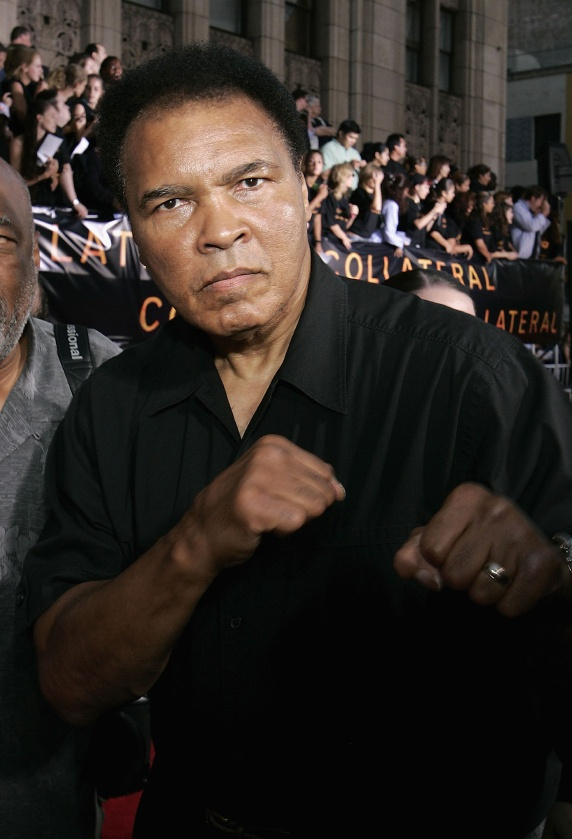 """LOS ANGELES - AUGUST 2:  Muhammad Ali arrives at the World Premiere of """"Collateral"""" at the Orpheum Theatre on August 2, 2004 in Los Angeles, California.  (Photo by Carlo Allegri/Getty Images)"""