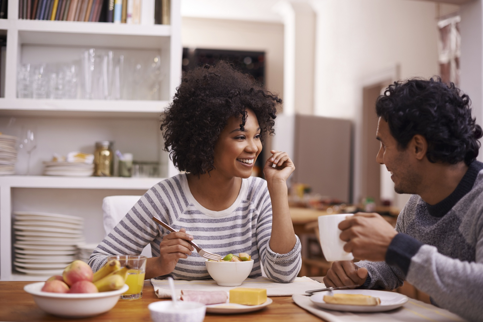 Shot of a happy couple enjoying breakfast together