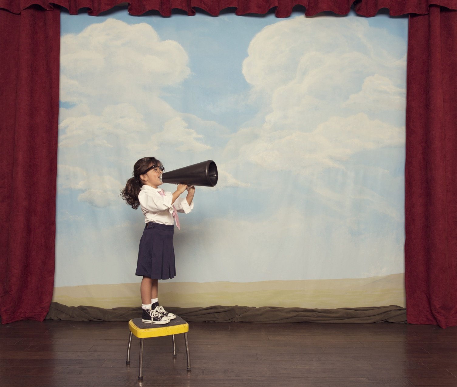 A young girl makes sure to have her voice heard for her business.