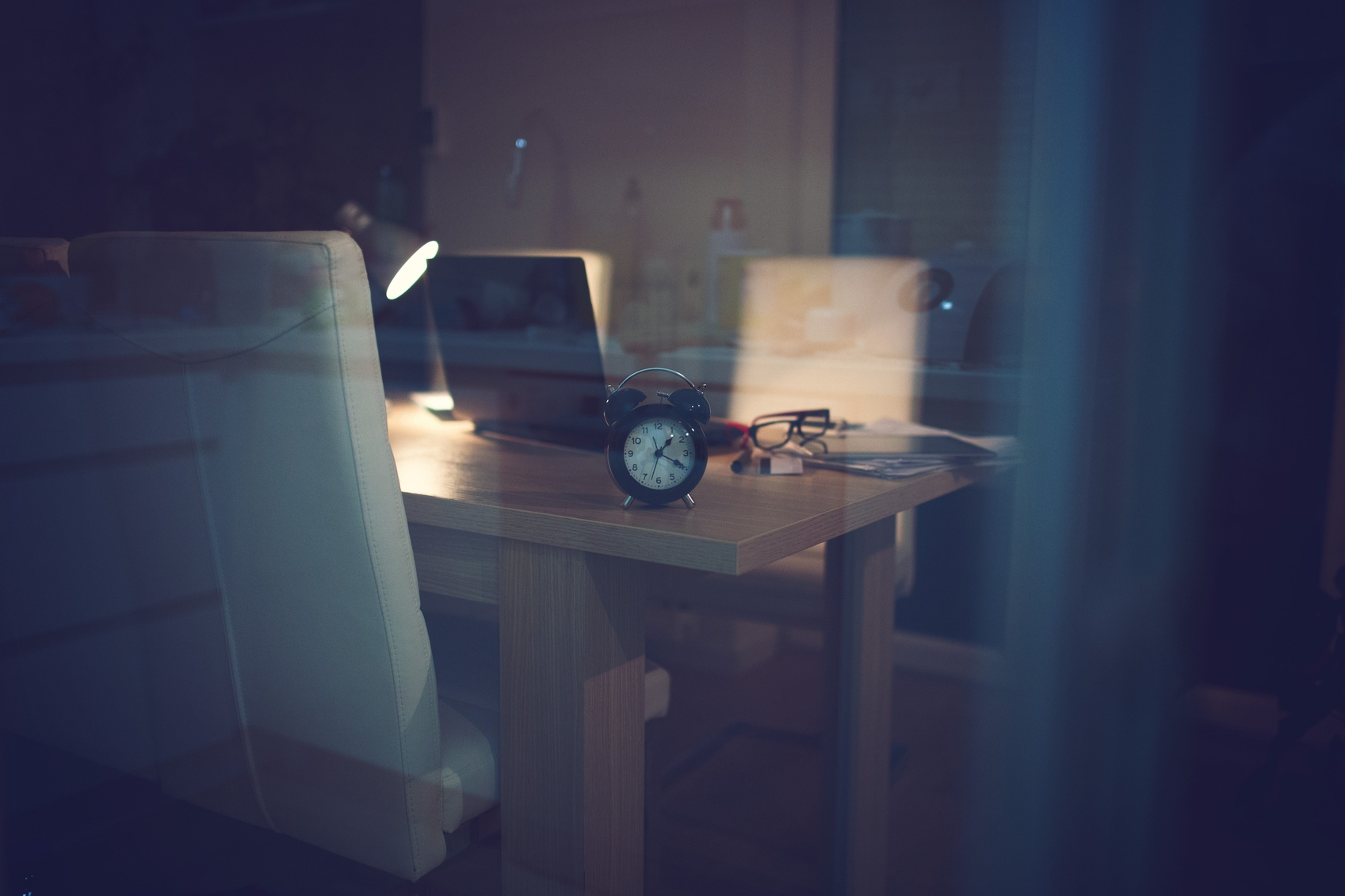 Low key photo of office supplies indicating night work from home