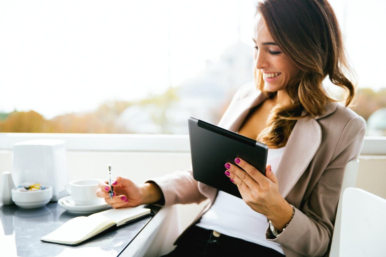 Portrait Of Successful Businesswoman Working At Cafè